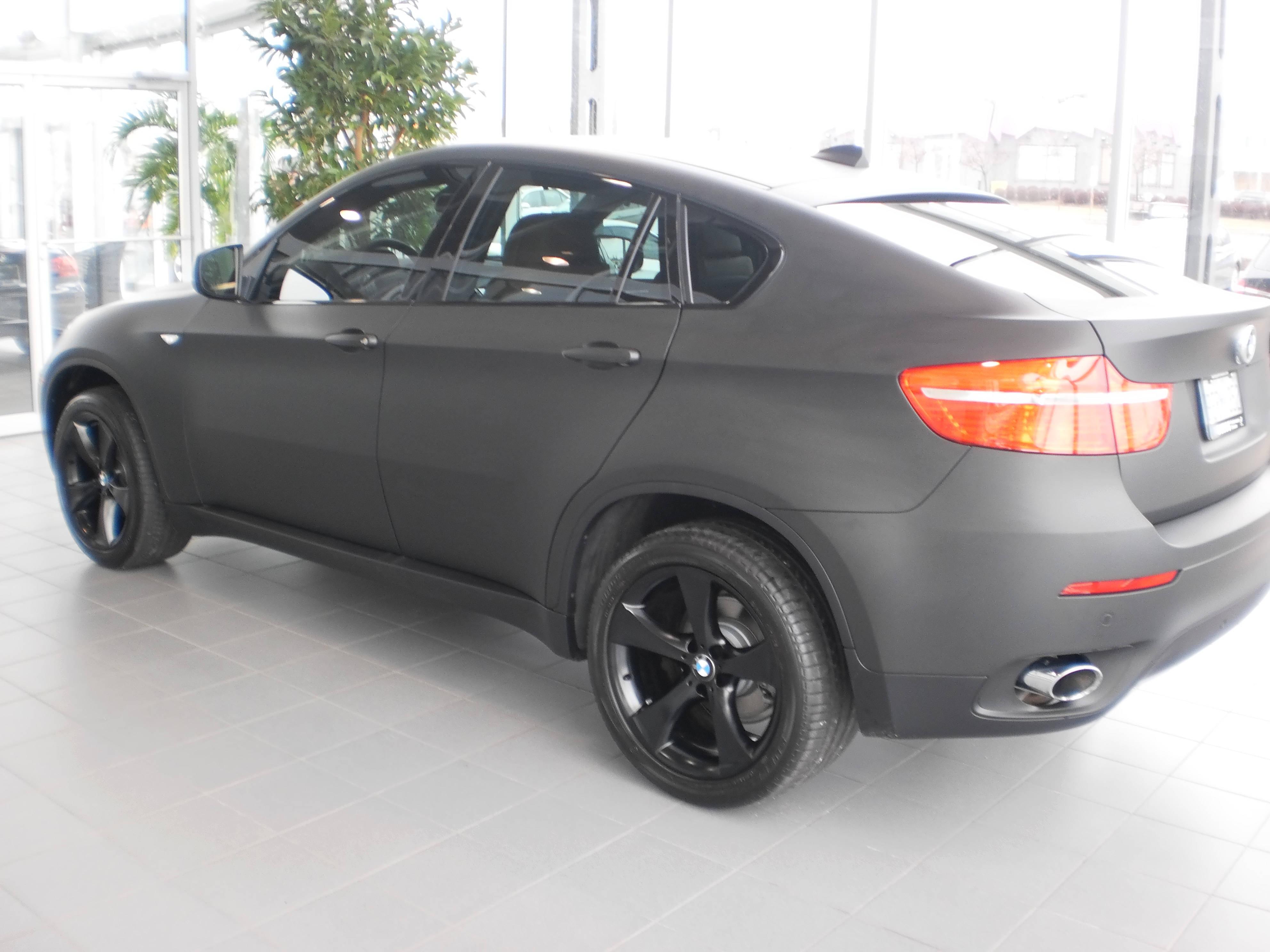 BMW X6 wrapped in 3M 1080 matte black by vWrapz at Budd's BMW in Hamilton ON